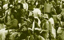 photo of large group of protesters, many in wheelchairs'